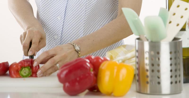 Woman cutting a red pepper